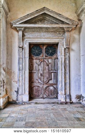 Old door in monastery. Pazaislis monastery and church is a large monastery complex in Kaunas Lithuania and the example of Italian Baroque architecture