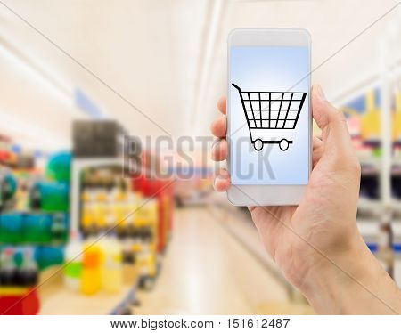 Closeup of hands using smartphone in supermarket .screen content is designed by us and not copyrighted by others and created with wacom tablet and ps