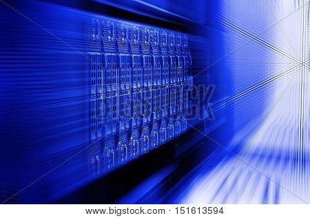 blade server server equipment rack data center closeup blur blue toning