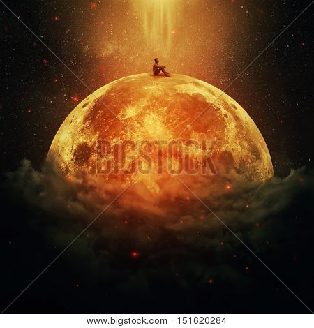 Young boy standing alone on a planet above the clouds