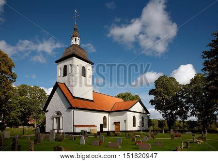 White old Swedish church building located in Vardinge