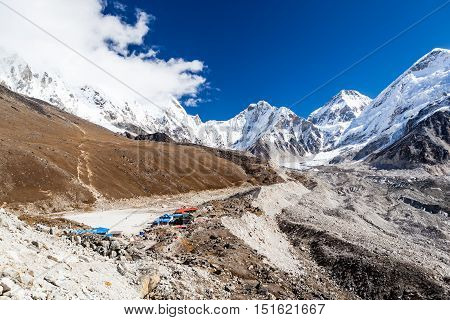 Inspirational Himalaya Mountains Landscape. People climbing and hiking on Khumbu glacier in Himalayas Nepal. Trekking on autumn sunny day inspiring and motivating sport and fitness concept.