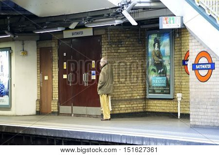 LONDON, UK - MARCH 31: An elderly man is standing at London's subway train station Bayswater waiting for the train on March 31 2015 in London.