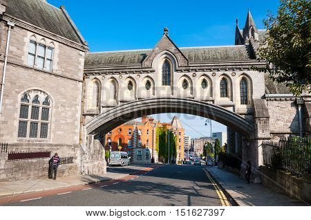 Arch of the Christ Church Cathedral in Dublin Ireland. People and traffic at the background