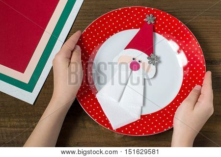 Creating a Christmas decoration for table setting. Decor for serviette in form of Santa Claus. Children project step by step photo instructions. Step 10. Decor for serviette on a plate