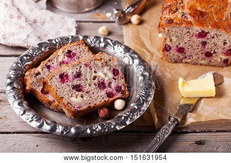 Cranberry and hazelnut wholegrain bead, loaf on a wooden background. Rustic style. Wooden background