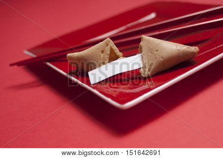 Fortune Cookie And Chopsticks In Square Red Plate