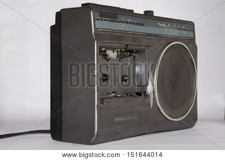 Old broken radio isolated on white background
