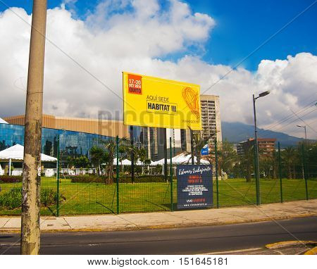 QUITO, ECUADOR -8 OCTOBER, 2016: Area outside Casa de la cultura, venue of the third United Nations Habitat conference, large yellow sign announcing current event, nice beautiful blue sky.