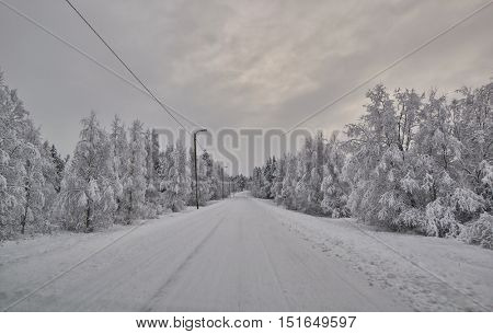 Scenic road in northern Finland in Winter just after snow blizzard