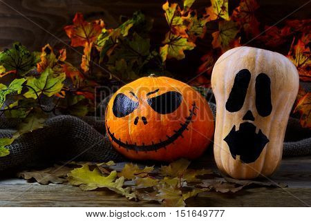 Halloween Stingy Jack pumpkins on dark rustic background. Halloween symbol jack-o-lantern background. Halloween decoration.