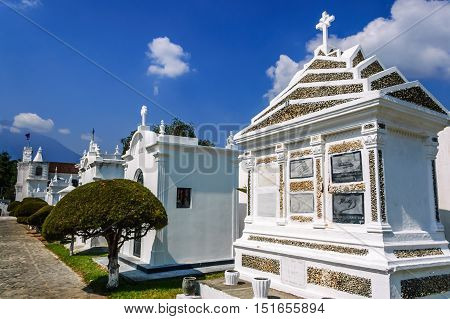 San Lazaro Cemetery Antigua Guatemala - May 6 2012: View through cemetery with of Agua volcano behind in Spanish colonial town of Antigua