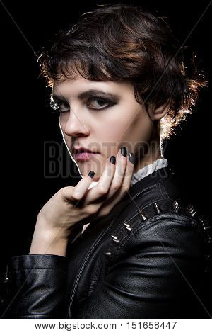 Goth style punk female wearing black manicure or press on nail art on fingernails