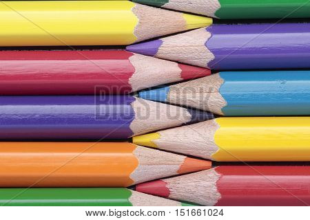 foreground of some crayons interleaved on a horizontal composition