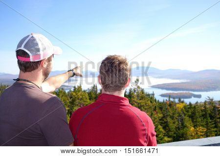 pair of hikers pointing at the horizon