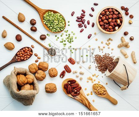 Bowls And Spoons Of Various Legumes And Different Kinds Of Nuts Walnuts Kernels ,hazelnuts, Almond K