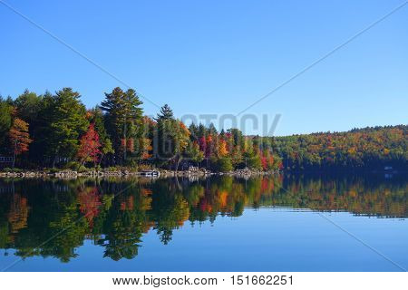 lake symmetry on a beautiful autumn day in new england