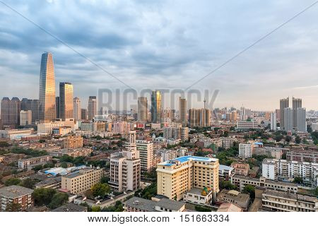 sunset shining on the modern architecture cityscape of tianjin at dusk