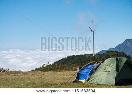 camping tents wind turbine and the sea of clouds at jiugong mountain hubei provinceChina
