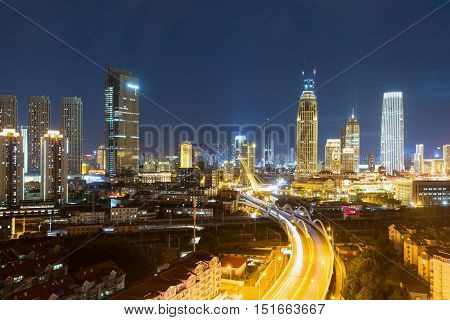 tianjin night scene of city road bridge with business district China