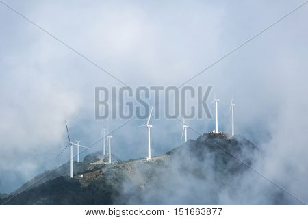wind farms in the misty clouds on the jiugong mountains hubei provinceChina
