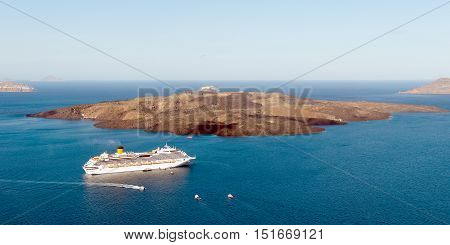 Cruise ships in Thira Santorini island Greece. Panoramic view of the town of Fira