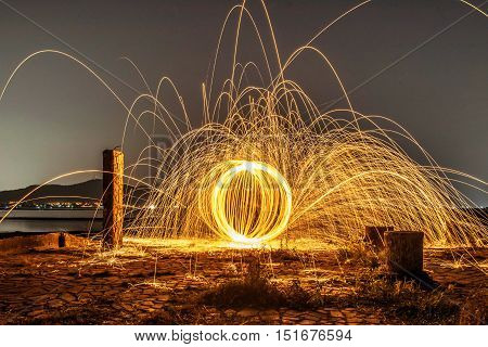 Long Exposure Burning And Spinning Of Steel Woolon The Ground.