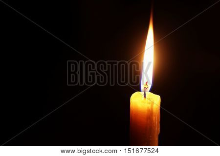 candle flame isolated on black religion concept