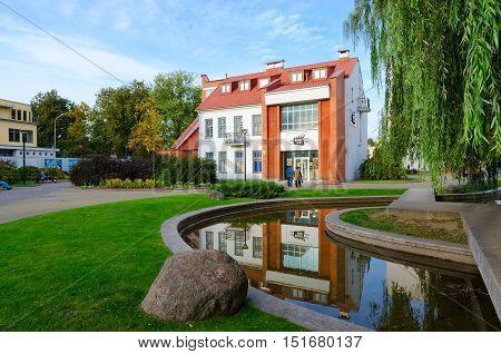 MINSK BELARUS - OCTOBER 1 2016: Unidentified people walk near building of Museum of History of Belorussian cinema Minsk Belarus