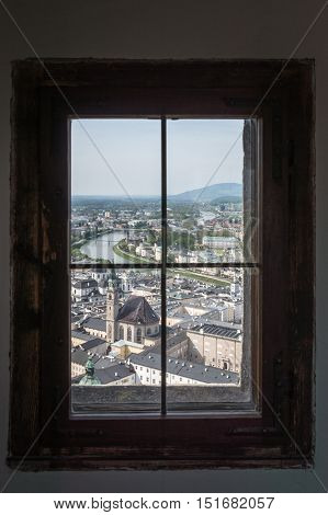 Salzburg Austria - April 29 2015: Framed view of the city from Hohensalzburg Castle. Salzburg is renowned for its baroque architecture and was the birthplace of Mozart. It is an Unesco World Heritage Site.