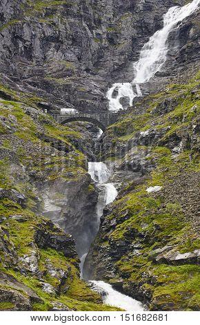 Norwegian mountain road. Waterfall stone bridge. Trollstigen. Stigfossen. Norway tourism