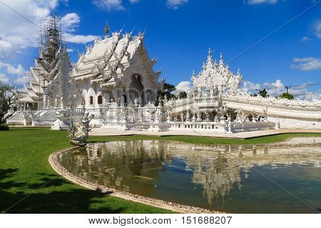 Wat Rong Khun on repairing situation, perhaps better known to foreigners as the White Temple, art exhibit in the style of a Buddhist temple in Chiang Rai Province, Thailand.