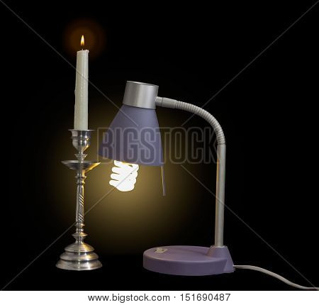 Luminous light fixture with compact fluorescent lamp and burning candle in an old metal candlestick on a dark background