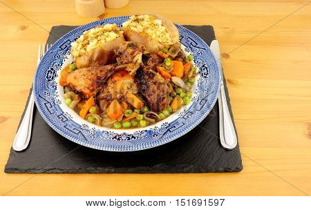Chicken casserole meal with baked jacket potatoes