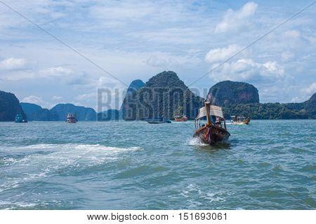 PHUKET, THAILAND, on 11 NOVEMBER, Long boat and rocks in the Gulf of Thailand the island of Phuket on November 11, 2014