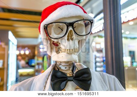Funny portrait of a skeleton dressed as Santa Claus hat. Conceptual christmas holidays.