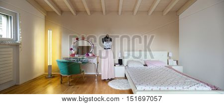 Wide bedroom of a teenager in a loft