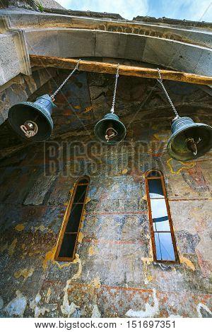 VARDZIA GEORGIAThe bells of Dormition cave church with its facade wall covered by frescoes Vardzia.