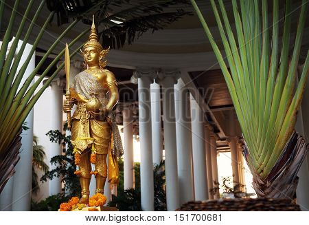Pattaya Thailand - March 22 2016: Golden Rama statue wearing traditional costume. Gold Hindu god sculpture holding sword and cloth sack