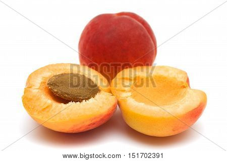 Fresh organic apricots on a white background.