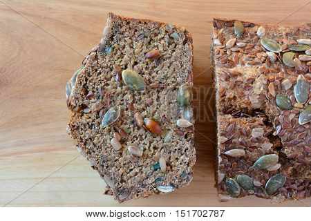 Sliced chrono organic unleavened bread with various seeds pumpkin sunflower flax seeds delicious and very healthy close up view from above