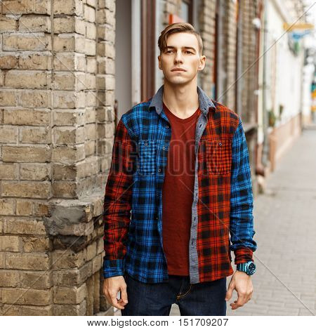 Handsome Stylish Man In Fashionable Checked Shirt Near The Vintage Brick Wall
