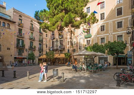 BARCELONA, SPAIN - SEPTEMBER 21. Plaza in the old town of Barcelona. The Placa del Pi in the Barri Gotic as part of Ciutat Vella. Tourists enjoy the sunny day in Barcelona on September 21, 2016