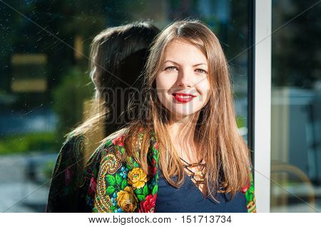 Smiling Woman Near Mirror Wall.