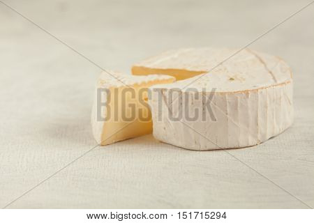 Fresh Brie Cheese With White Mold On A White Background