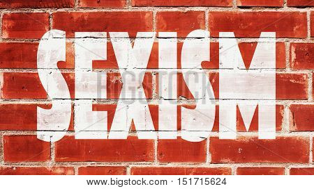 Sexism  Written On A Red Brick Wall
