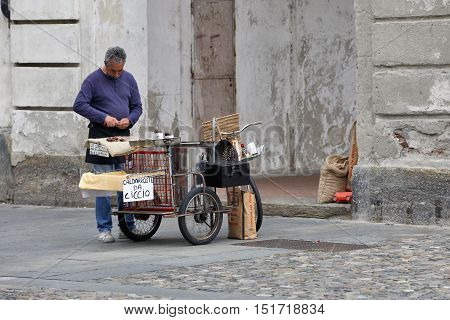 VENARIA REALE ITALY - OCTOBER 1: Seller of roasted chestnuts on Piazza SS.Annunziata in the small town of Venaria Reale near Torino Italy on October 1 2016