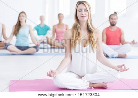 People Sitting Concentrated On Yoga Class