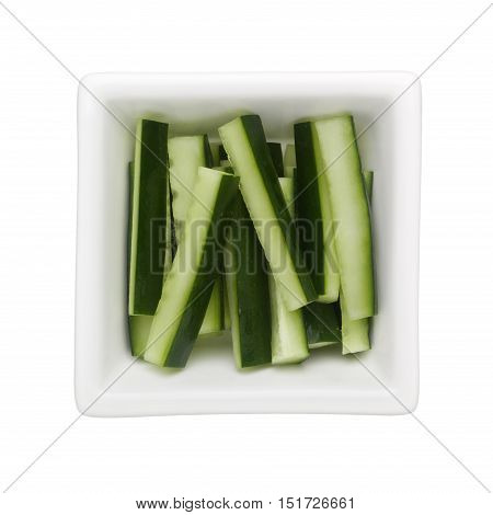 Japanese cucumber sticks in a square bowl isolated on white background