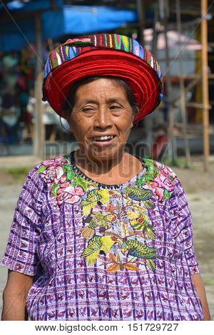 SANTIAGO DE ATITLAN GUATEMALA APRIL 29 2016: Tzutujil woman wearing a traditional toyocal hat. The Mayan people still make up a majority of the population in Guatemala,